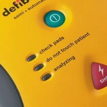 Defibtech Lifeline AED equiped with two bright operation buttons